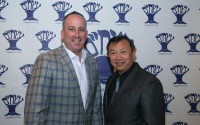 Etz Chaim Vice President Randy Figur and retired Maj. Jerry Quan mark years of friendship.