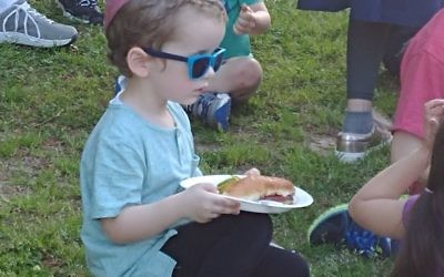 A hot dog comes before the magic show for this child.
