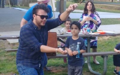 A magician keeps the young crowd mesmerized at East Cobb Park during Chabad of Cobb's Lag B'Omer picnic Thursday, May 3.