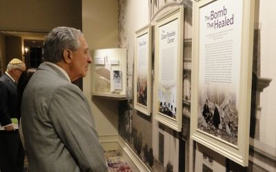Atlanta Falcons owner Arthur Blank takes a walk through the past at The Temple's History Wall. (Photo by Kevin C. Madigan)
