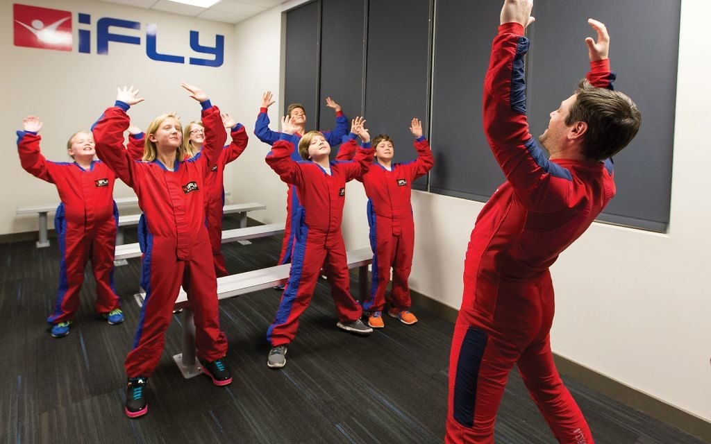 Before entering the wind tunnel, you must take a 10-minute class with an instructor and watch a video to learn the proper signals and body positions. (Photo courtesy of iFly)