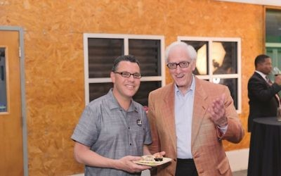 Atlanta Jewish Film Festival executive director Kenny Blank and AJT contributer Bob Bahr take time for a bite.