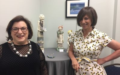 Sisters Judy Robkin (left) and Anita Stein display their contrasting art styles in a new exhibit at MACoM in Sandy Springs. (Photo by Marcia Caller Jaffe)