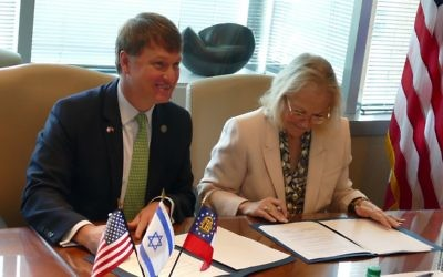 Economic Development Commissioner Pat Wilson and Ambassador Judith Varnai Shorer sign the memo of understanding June 7.