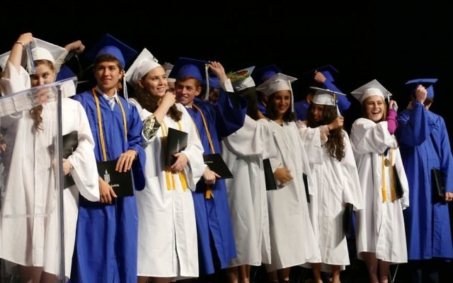 Members of the Class of 2018 flip their tassels to mark their transition from Atlanta Jewish Academy students to alumni.