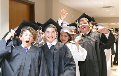 (From left) Logan Bucovetsky, Harrison Frank, Hannah Ferrar, Evan Feintuch and Sam Durbin get excited for their Davis Academy graduation.