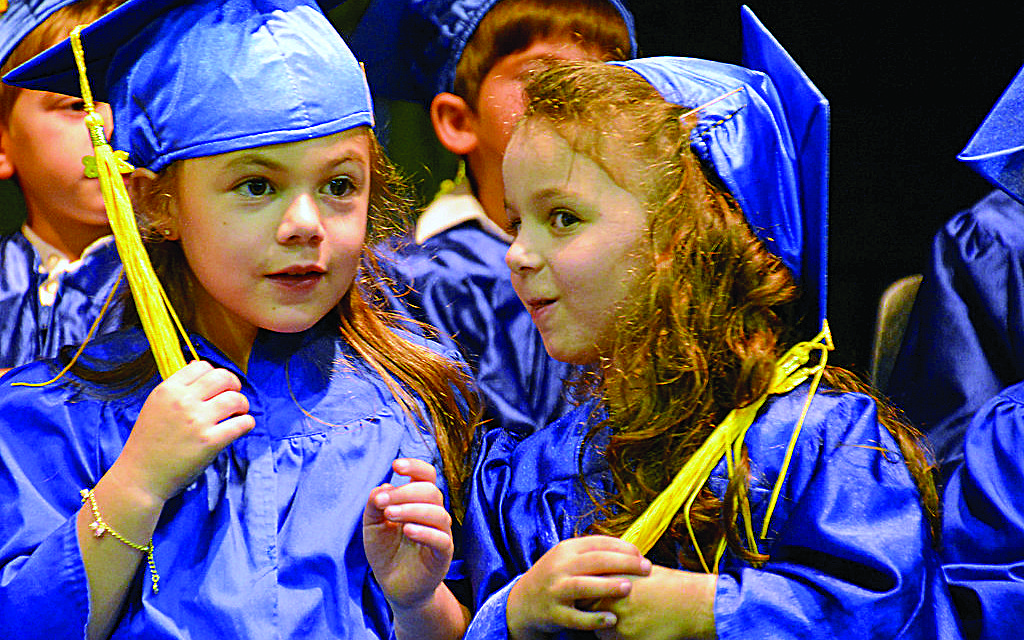 Two of the 38 kindergarten students that graduated from the Torah Day School of Atlanta on Tuesday, June 12. Many will continue their studies at the school.