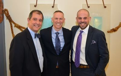The Marcus JCC's new board chair, Ken Winkler, is flanked by his predecessor, Joel Arogeti (left), and CEO Jared Powers. (Photo by Jennifer Sami)