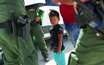Photo by John Moore/Getty Images -  U.S. Border Patrol agents take into custody a father and son from Honduras near the U.S.-Mexico border on June 12, 2018 near Mission, Texas.