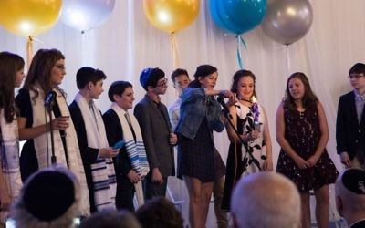 Jewish Kids Groups' Havdalah b'nai mitzvah service marks the completion of a two-year Jewish journey for eight middle-schoolers May 19.