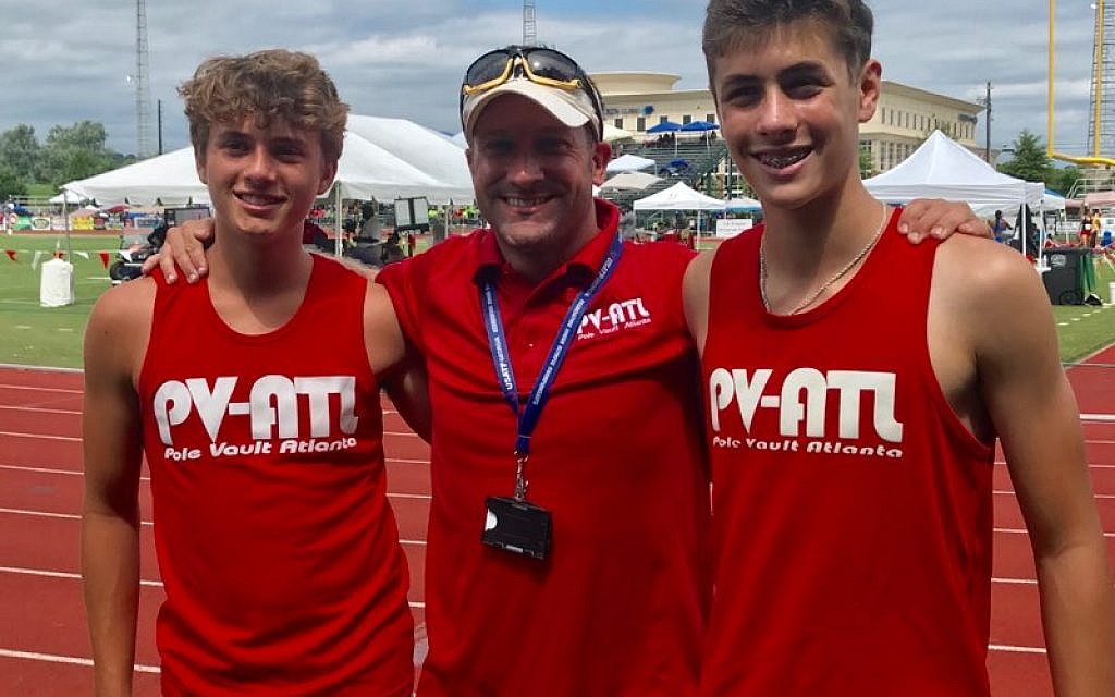 Coach Matt Barry (middle) stands with Nick West (left) and Alon Rogow (right), who qualified for the National Junior Olympic Track & Field Championship.