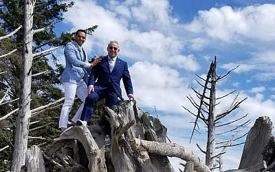 """Rabbi Joshua Lesser and Alessandro  """"Alex"""" Ramaldes show the great heights they've scaled to be married."""