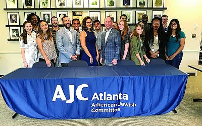 American Jewish Committee Regional Director Dov Wilker, Welcome Atlanta Director Michelle Maziar and Hands on Atlanta President and CEO Jay Cranman, center, teach interns from different Atlanta interfaith agencies. (Photo by Leah Gross)