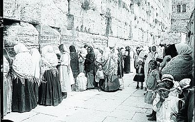 The Western Wall in 1898 with some stones containing writings in Hebrew, believed to be the work of visitors who wanted to commemorate their names upon the wall.