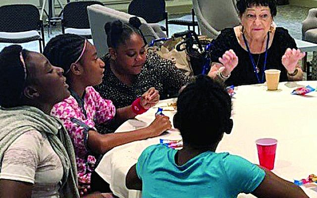 Holocaust survivor Bebe Forehand shares her story of survival with homeless children.