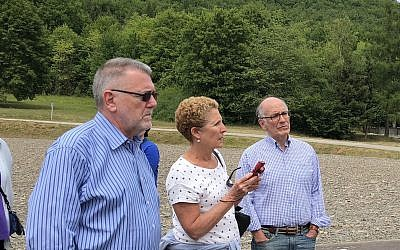 Judy Schancupp takes notes at Dora-Mittelbau with historian Peter Hayes and JFR board member Steven Field.
