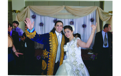 The newlyweds, Vladislav and Marieta Iskhakov, in traditional embroidered Bukharian chapan robes.