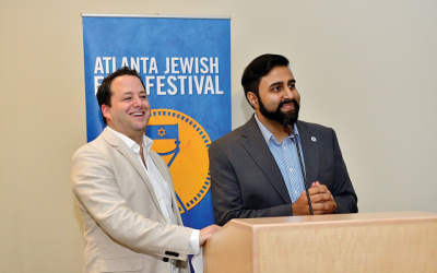 Keynote speaker Rabbi Brad Levenberg of Temple Sinai and Munir Meghjani of the Ismaili Center in Norcross.