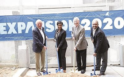 Breaking ground on the aquarium expansion are, from left, Mike Leven, Mayor Keisha Lance Bottoms, Bernie Marcus and Joe Handy.