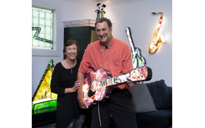 Photos by Duane Stork unless otherwise noted // Diane and Paul Heller transferred their love of music into his art, creating illuminated 3-D glass with instruments … especially guitars. Note the saxophone on the wall where Paul uses real instrument pieces in his sculptures. A Heller sailboat is on the left.