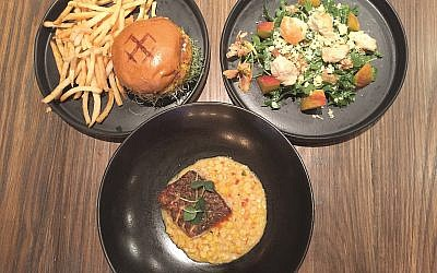 From left: Trout burger platter, arugula peach salad and, the author's favorite, red fish on corn maque choux.