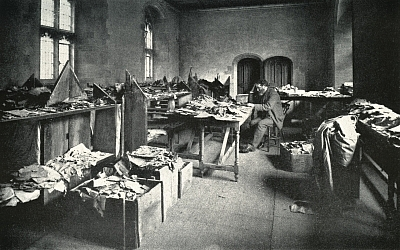 Solomon Schechter, at Cambridge University in 1898, surrounded by packing crates and the contents of the genizah from the Ben Ezra Synagogue in Cairo.