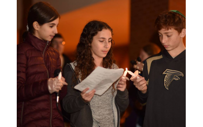 Photos by Beth Intro Photography // Eighth graders Eva Beresin, Ayla Cohen and Josh Shulman starting the candle lighting.