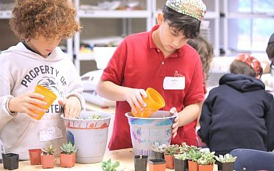 Fourth-grade students Jacob Ross and Zachary Covin decorated and planted pots to show their gratitude for their teachers.