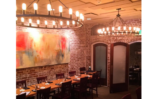 Nowak's warm brick interior was renovated by Tom Murphy. Blaiss visited 12 venues before choosing the North Highland locale.