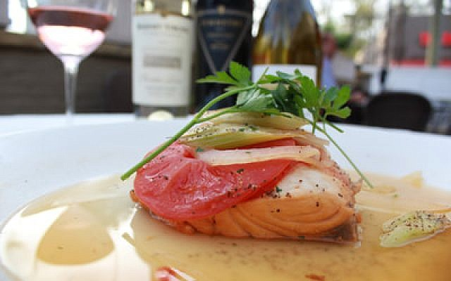 Nowak's New Orleans origins are showcased with white wine sauce, celery, tomatoes and onions on the American Gulf redfish.