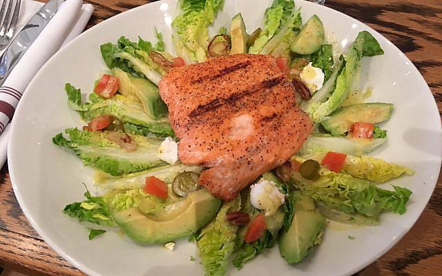 The popular salmon salad boasts avocado, pecans, jalapenos and shallots.