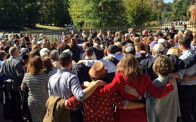 Members of Young Israel of Toco Hills and Congregation Bet Haverim met in a street between their synagogues in a sign of Jewish unity on the Shabbat after the Pittsburgh synagogue killings.