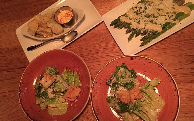 Deliciousness before the entrée (clockwise from top left): Rice flour flash-fried artichokes, asparagus Parmesan, authentic Caesar salad (split in two portions).