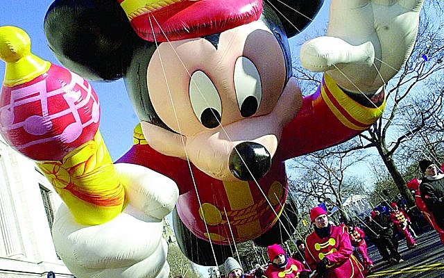 UNITED STATES - CIRCA 2000:  Handlers guide the bandleader Mickey Mouse balloon as it leads the 74th annual Macy's Thanksgiving Day Parade down Broadway.  (Photo by Susan Watts/NY Daily News Archive via Getty Images)