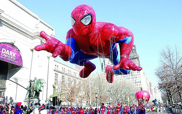 NEW YORK, NY - NOVEMBER 28:  Spiderman balloon floats in the 87th Annual Macy's Thanksgiving Day Parade on November 28, 2013 in New York City.  (Photo by Laura Cavanaugh/Getty Images)