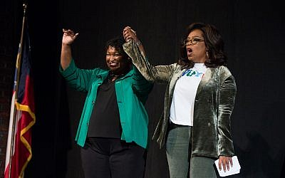 Photo by Jessica Mcgowan/Getty Images // Oprah Winfrey holds a town hall-style interview with Democratic gubernatorial candidate Stacey Abrams in Cobb County.