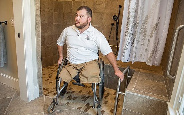 US Marine Corps Cpl. Sean Adams lost both legs above the knee, injured both hands and injured his right arm.