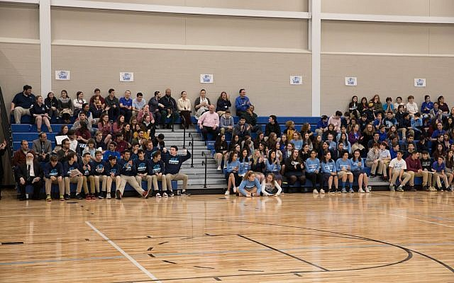 Student athletes gather to celebrate the new gym.