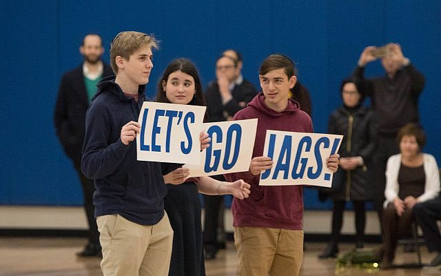 """AJA students show off their school spirit, practicing their """"Let's go Jags"""" cheers."""