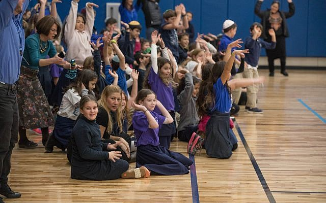 Students of all ages got into the celebration of the new space with a 'wave.'