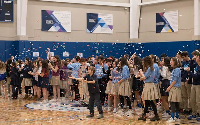 AJA students of all ages enjoyed a pep rally in the newly completed gym.