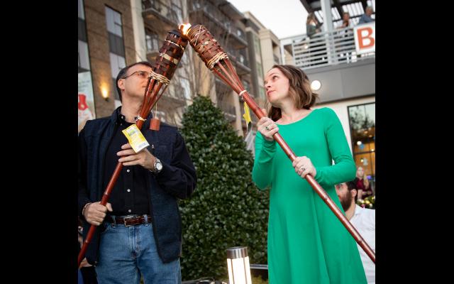 Alla Umanskiy and Scott Scher light the shamash.
