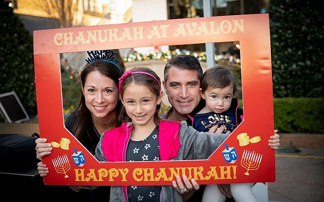 Friends and families of all ages gathered to enjoy holiday-inspired refreshments, exclusive giveaways and musical entertainment for this year's menorah lighting at Avalon.