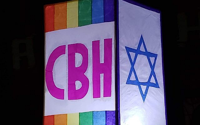 A close-up of the lighted CBH sign that Rabbi Joshua Lesser carried as he led members in the Chanukah BeltLine march.