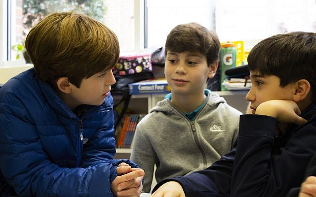 Students engage in discussion about their similarities and differences.