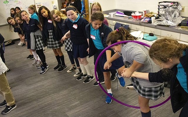 Fifth-grade girls from Davis and Mount Vernon schools work together in a team building activity.