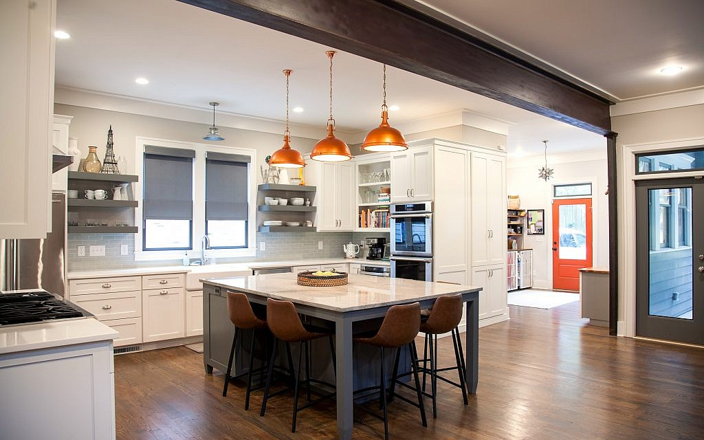 The spacious kitchen has stainless steel fixtures and Lauren's specially-selected quartz transported from New Jersey.