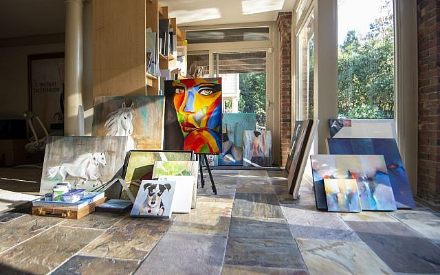 Linda's art studio is grounded on stone with a bounty of natural light.