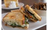 Firepit Pizza Tavern serves up a grilled portabella sourdough sandwich that oozes sharp white cheddar.