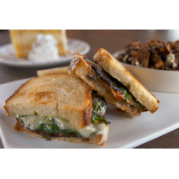 Firepit Pizza Tavern serves up a grilled portabella sourdough sandwich that oozes sharp white cheddar.
